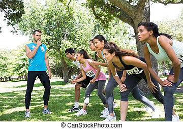 Trainer whistling while runners ready to race - Trainer...