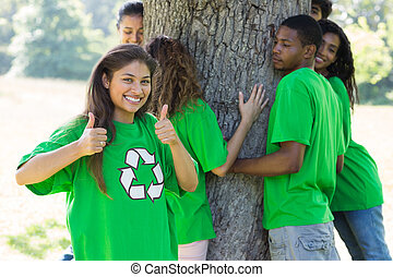 Environmentalist showing thumbs up - Portrait of confident...
