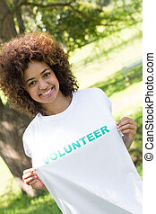 Environmentalist holding volunteer tshirt - Portrait of...
