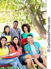 Happy college students at campus - Portrait of happy college...