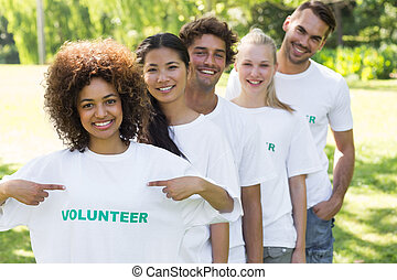 Environmentalist showing volunteer tshirt - Portrait of...
