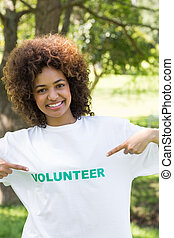 Environmentalist pointing at volunteer tshirt - Portrait of...
