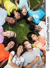 Group of friends lying down in park - High angle view of a...