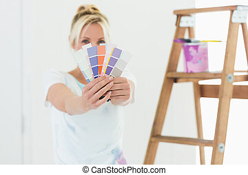 Blurred woman holding color swatche