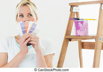 Woman holding color swatches in new