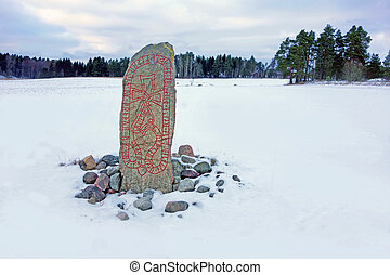 Runestone in a winter landscape - A picture of a swedish...