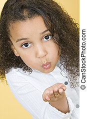 Girl Blowing Kisses - Studio shot of a beautiful young mixed...