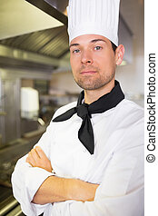 Closeup of a male cook in the kitchen - Closeup portrait of...