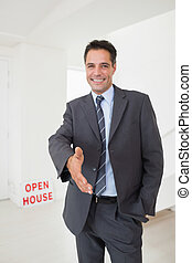 Well dressed smiling real estate ag - Portrait of a well...