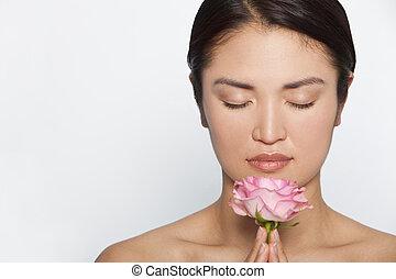 Zen Rose - Studio shot of a beautiful young Japanese woman...