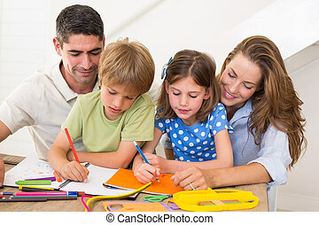 Family coloring together at home - Family of four coloring...