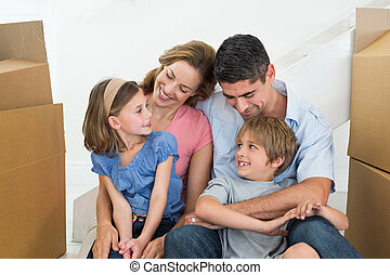 Happy family sitting in new house