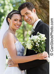 Happy newly wed couple in garden