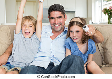 Father with children watching TV - Portrait of happy father...