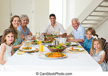 Family having meal together at dining table - Portrait of...