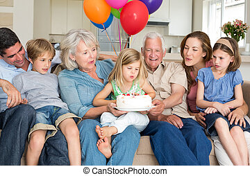Family celebrating girls birthday - Multigeneration family...
