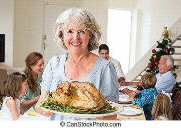Happy grandmother with Christmas meal