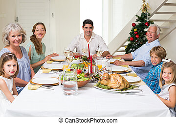 Family having Christmas meal together - Happy...