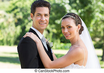 Bride and groom smiling in garden - Portrait of bride and...