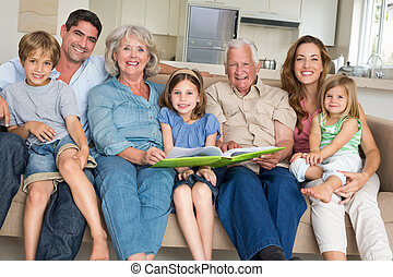Family with storybook at home - Portrait of happy...