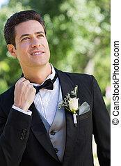 Nervous bridegroom in garden - Nervous bridegroom looking up...