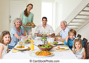 Family having meal at dining table - Portrait of happy...