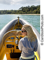 Beautiful Woman in a Speedboat - A stunningly beautiful...