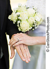 Bride and groom showing wedding rings - Closeup of bride and...