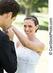 Groom kissing on hand of beautiful bride - Young groom...