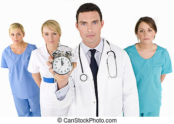 Your Time Is Running Out - A male doctor backed by his...