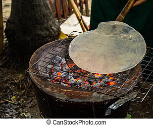 Stove - Indigenous rice cracker on stove