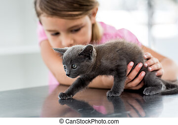 Girl playing with kitten - Little girl playing with kitten...