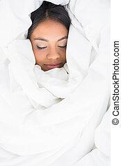 Sleeping girl wrapped up in her duvet