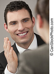 Executive Communication - A young male executive explains to...