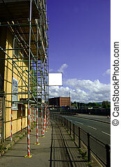 scaffolding - a roadside building with scaffolding attached...