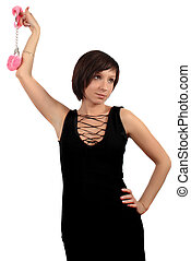 dark haired girl with pink handcuffs