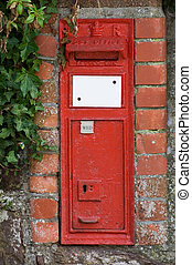 old mailbox - an overgrown old bristish post box embedded in...