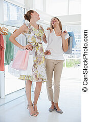 Happy female friends with shopping