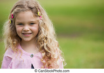 Close-up portrait of smiling girl at park