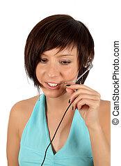 young girl with head phones isolated over white