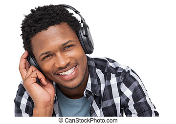 Close-up portrait of a young man enjoying music