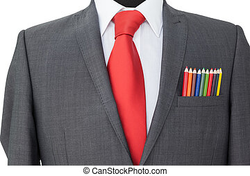 Close-up of colored pencils in coat pocket