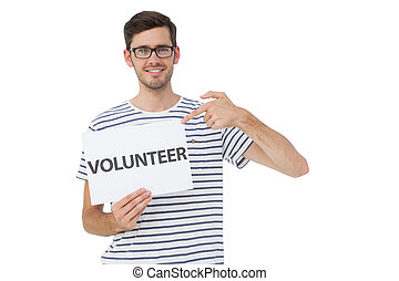 Happy man pointing at donation welcome note - Portrait of a...