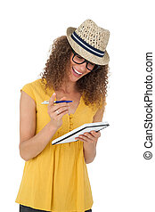 Cheerful young woman writing in notepad