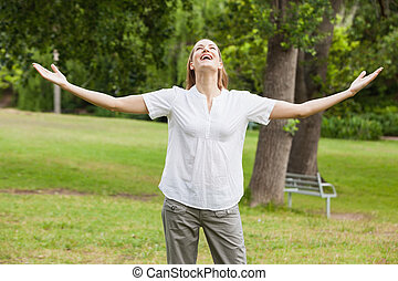 Woman with arms outstretched at par