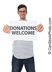 Portrait of a man holding a donation welcome note - Portrait...