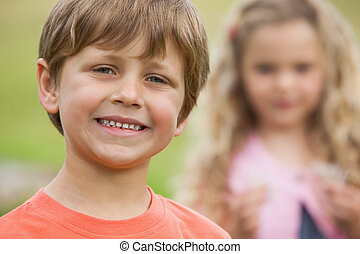 Close-up of smiling kids at park