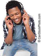 Close-up of a young man enjoying music
