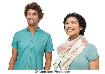 Portrait of a cheerful casual young couple over white...