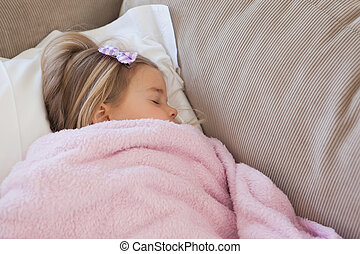 High angle view of a girl sleeping on sofa - High angle view...